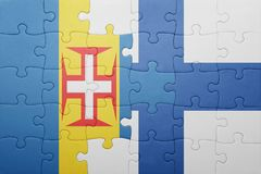 Puzzle with the national flag of madeira and finland. Concept Stock Photography