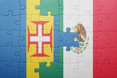 Puzzle with the national flag of madeira and mexico. Concept royalty free stock image