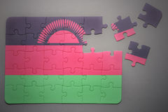 Puzzle with the national flag of malawi Royalty Free Stock Images