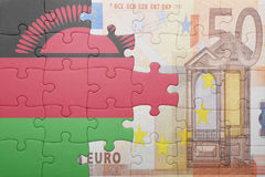 Puzzle with the national flag of malawi and euro banknote Stock Images
