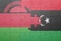 Puzzle with the national flag of malawi and libya. Concept Royalty Free Stock Photos