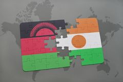 Puzzle with the national flag of malawi and niger on a world map. Background. 3D illustration Royalty Free Stock Photo