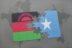 Puzzle with the national flag of malawi and somalia on a world map. Background. 3D illustration stock photo