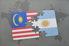 Puzzle with the national flag of malaysia and argentina on a world map background. Stock Images