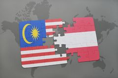 Puzzle with the national flag of malaysia and austria on a world map background. 3D illustration Royalty Free Stock Photo