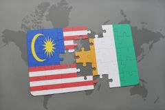 Puzzle with the national flag of malaysia and cote divoire on a world map background. 3D illustration Stock Photos