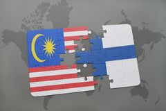 Puzzle with the national flag of malaysia and finland on a world map background. 3D illustration Stock Photos