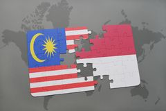 Puzzle with the national flag of malaysia and indonesia on a world map background. 3D illustration Stock Photo