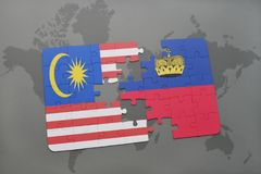 Puzzle with the national flag of malaysia and liechtenstein on a world map background. Stock Photo