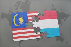 Puzzle with the national flag of malaysia and luxembourg on a world map background. 3D illustration Stock Photography