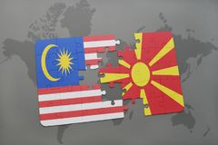 Puzzle with the national flag of malaysia and macedonia on a world map background. Stock Photo
