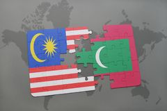 Puzzle with the national flag of malaysia and maldives on a world map background. Stock Photo