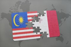 Puzzle with the national flag of malaysia and malta on a world map background. Royalty Free Stock Images