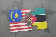 Puzzle with the national flag of malaysia and mozambique on a world map background. 3D illustration Stock Photo