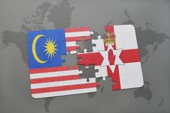 Puzzle with the national flag of malaysia and northern ireland on a world map background. 3D illustration Stock Photo