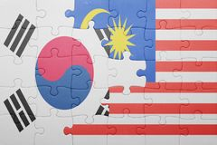 Puzzle with the national flag of malaysia and south korea. Concept stock photo