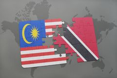 Puzzle with the national flag of malaysia and trinidad and tobago on a world map background. 3D illustration Stock Photos