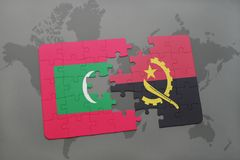 Puzzle with the national flag of maldives and angola on a world map. Background. 3D illustration Royalty Free Stock Photo