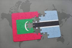 Puzzle with the national flag of maldives and botswana on a world map Royalty Free Stock Photo