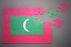 Puzzle with the national flag of maldives Royalty Free Stock Images