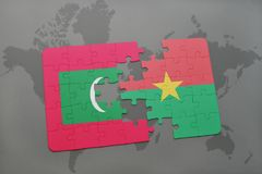 Puzzle with the national flag of maldives and burkina faso on a world map Stock Photography