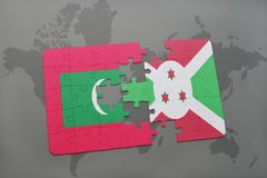 Puzzle with the national flag of maldives and burundi on a world map. Background. 3D illustration Royalty Free Stock Image