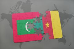 Puzzle with the national flag of maldives and cameroon on a world map. Background. 3D illustration Stock Photography
