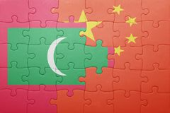Puzzle with the national flag of maldives and china Stock Image