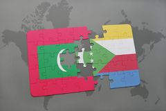 Puzzle with the national flag of maldives and comoros on a world map. Background. 3D illustration Royalty Free Stock Photography