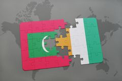 Puzzle with the national flag of maldives and cote divoire on a world map. Background. 3D illustration Royalty Free Stock Photo
