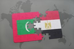 Puzzle with the national flag of maldives and egypt on a world map. Background. 3D illustration Stock Image