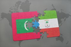 Puzzle with the national flag of maldives and equatorial guinea on a world map. Background. 3D illustration Stock Photo