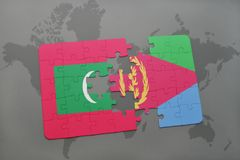 Puzzle with the national flag of maldives and eritrea on a world map. Background. 3D illustration Stock Images