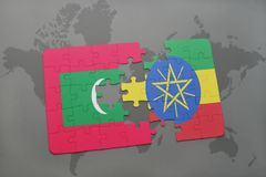 Puzzle with the national flag of maldives and ethiopia on a world map. Background. 3D illustration Stock Photo