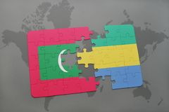 Puzzle with the national flag of maldives and gabon on a world map. Background. 3D illustration Stock Images