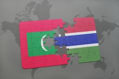 Puzzle with the national flag of maldives and gambia on a world map. Background. 3D illustration Stock Photos