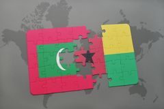 Puzzle with the national flag of maldives and guinea bissau on a world map. Background. 3D illustration Stock Image