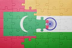Puzzle with the national flag of maldives and india Stock Photos