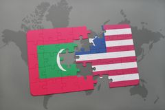 Puzzle with the national flag of maldives and liberia on a world map. Background. 3D illustration Royalty Free Stock Photos