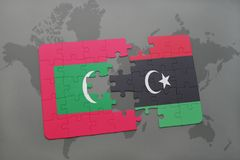 Puzzle with the national flag of maldives and libya on a world map. Background. 3D illustration Royalty Free Stock Photo