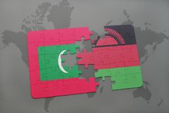 Puzzle with the national flag of maldives and malawi on a world map. Background. 3D illustration Royalty Free Stock Photos