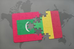 Puzzle with the national flag of maldives and mali on a world map. Background. 3D illustration Royalty Free Stock Images