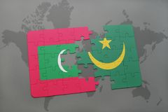 Puzzle with the national flag of maldives and mauritania on a world map. Background. 3D illustration Royalty Free Stock Image