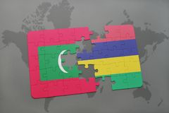 Puzzle with the national flag of maldives and mauritius on a world map. Background. 3D illustration Royalty Free Stock Images