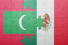 Puzzle with the national flag of maldives and mexico. Concept stock photo