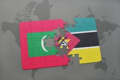 Puzzle with the national flag of maldives and mozambique on a world map. Background. 3D illustration Stock Photography