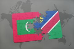 Puzzle with the national flag of maldives and namibia on a world map Royalty Free Stock Image