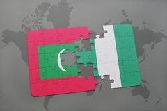 Puzzle with the national flag of maldives and nigeria on a world map. Background. 3D illustration Royalty Free Stock Photo