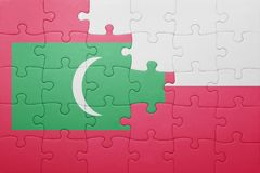 Puzzle with the national flag of maldives and poland Royalty Free Stock Images