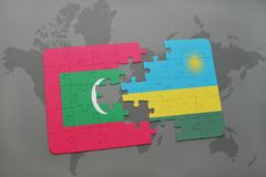 Puzzle with the national flag of maldives and rwanda on a world map. Background. 3D illustration Royalty Free Stock Image